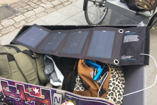 Anker 14W Solar Charger, Seen here on our cargos bike, Charging a Iphone while driving to new spot.